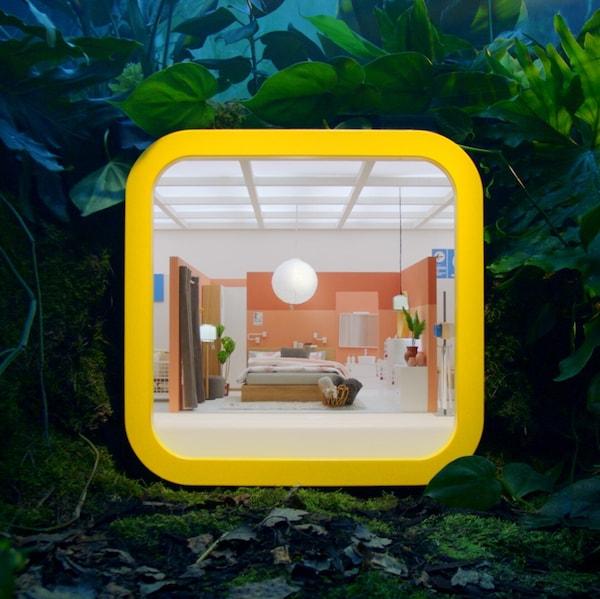 Szoba egy sárga dobozban, az IKEA Store appot szimbolizálva.