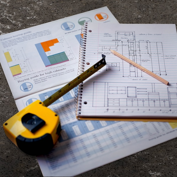 Tape measure on a table with kitchen plans