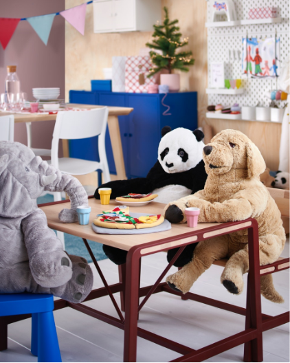 Teddy bear and stuffed dog sitting at the table