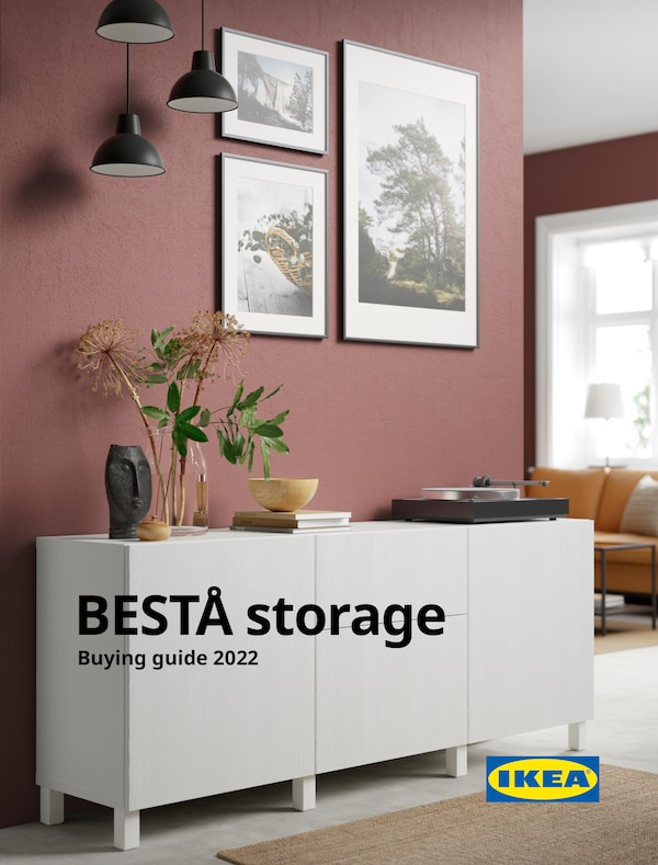 The cover of an IKEA BESTÅ brochure showing a BESTÅ unit, picture frames and vinyl player.