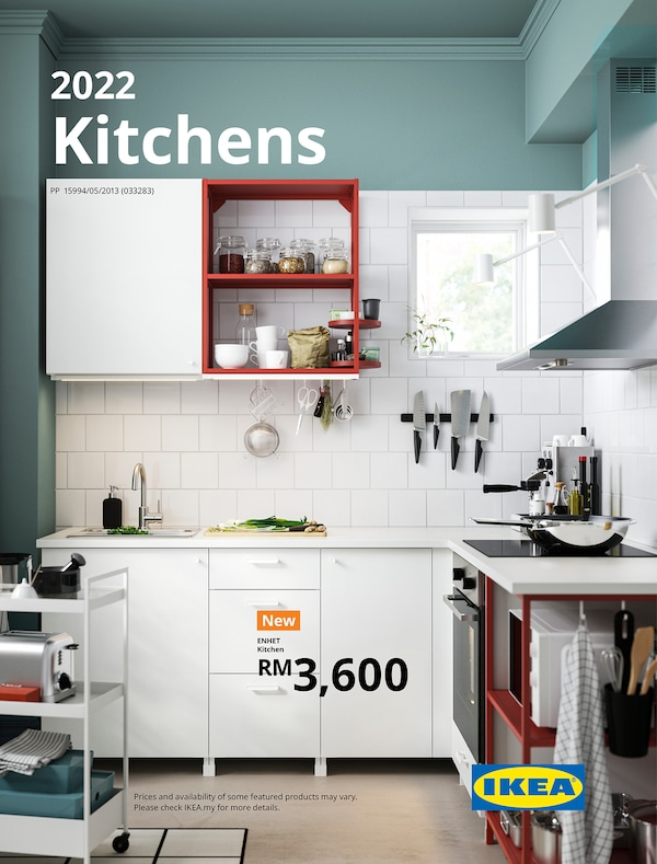 The cover of an IKEA Kitchens brochure showing a cooking area with kitchen trolley, stove, oven, microwave and extractor hood.