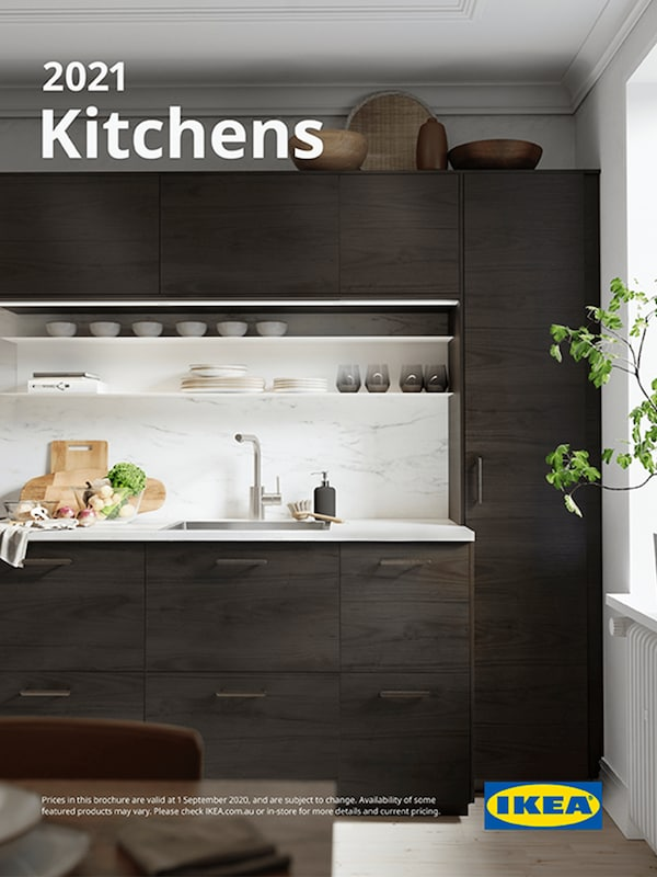 The cover of an IKEA Kitchens brochure showing a cooking area with stove, oven, microwave and extractor hood.