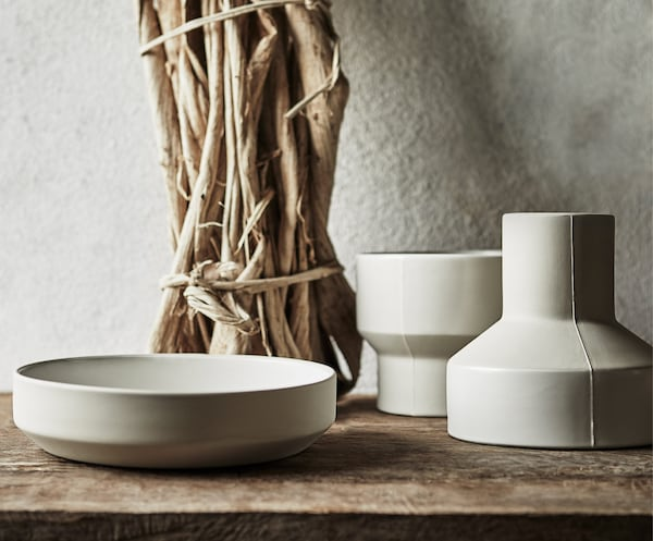 The HANTVERK ceramic bowl, plant pot, and vase, handmade in Thailand, placed on a table.