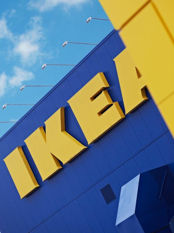 The IKEA blue box building with yellow IKEA logo.