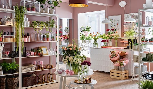 The interior of a pink-walled florist, overflowing with flowers and artifully arranged homewares.