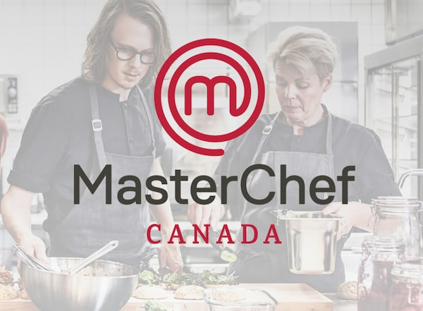 The MasterChef Canada logo. In the background are two chefs cooking a meal in the kitchen.