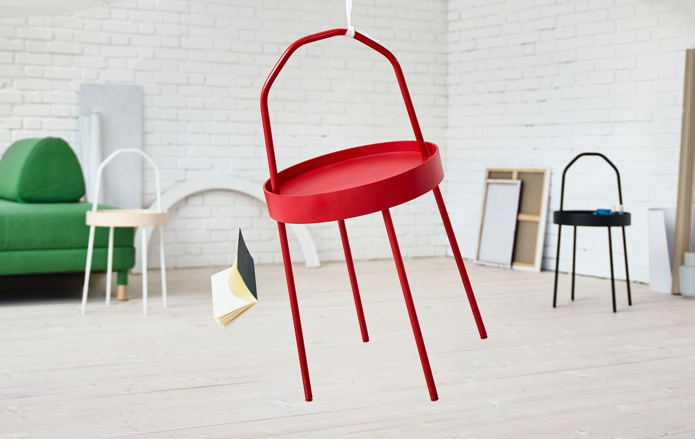 The new BURVIK side table in red, black and birch.
