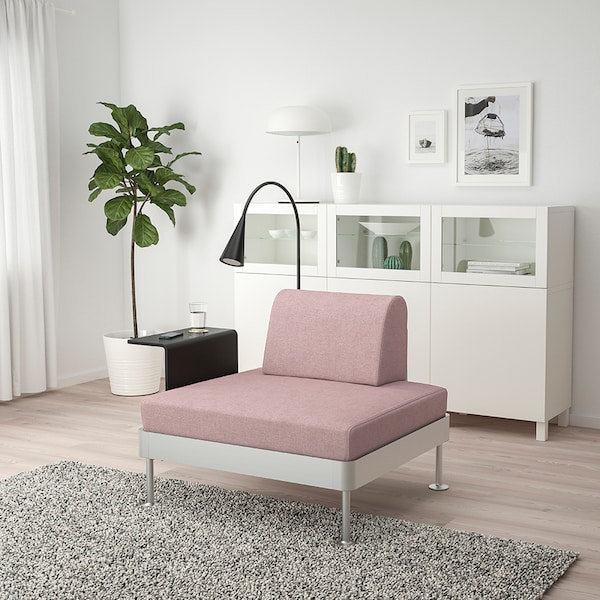 The new DELAKTIG covers in pink with a side table and LED lamp attached to a one-seater.