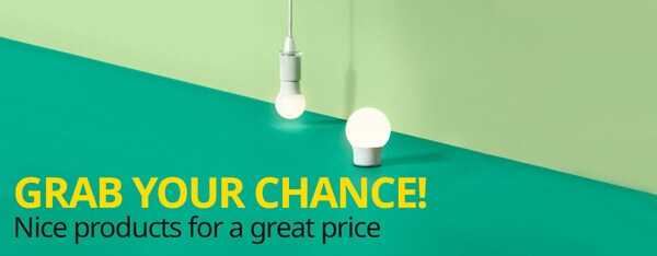 The RYAT LED lamp hangs in front of a green background.