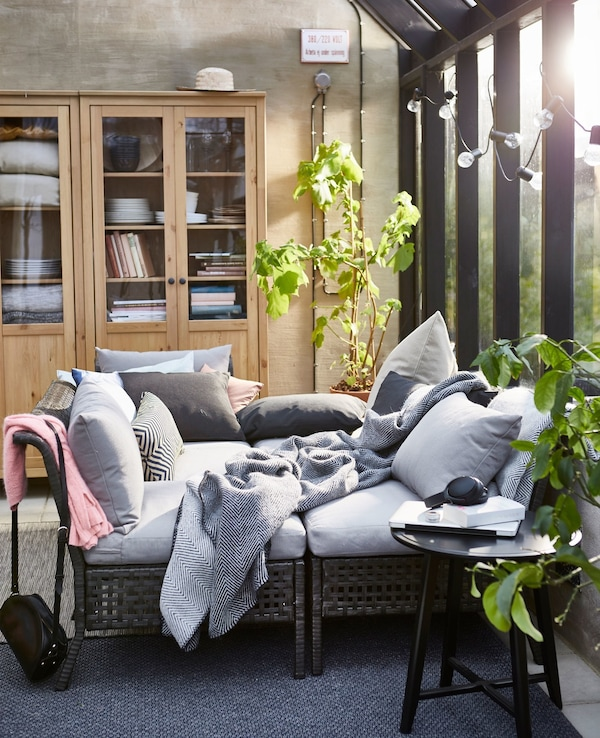 The sections in the KUNGSHOLMEN outdoor seating series are combined to form a cosy daybed.