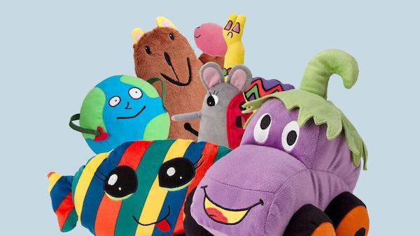 The six SAGOSKATT soft toys - Llama, Candy, Brown bear, Globe man, Eggplant car and Ladybugmouse.