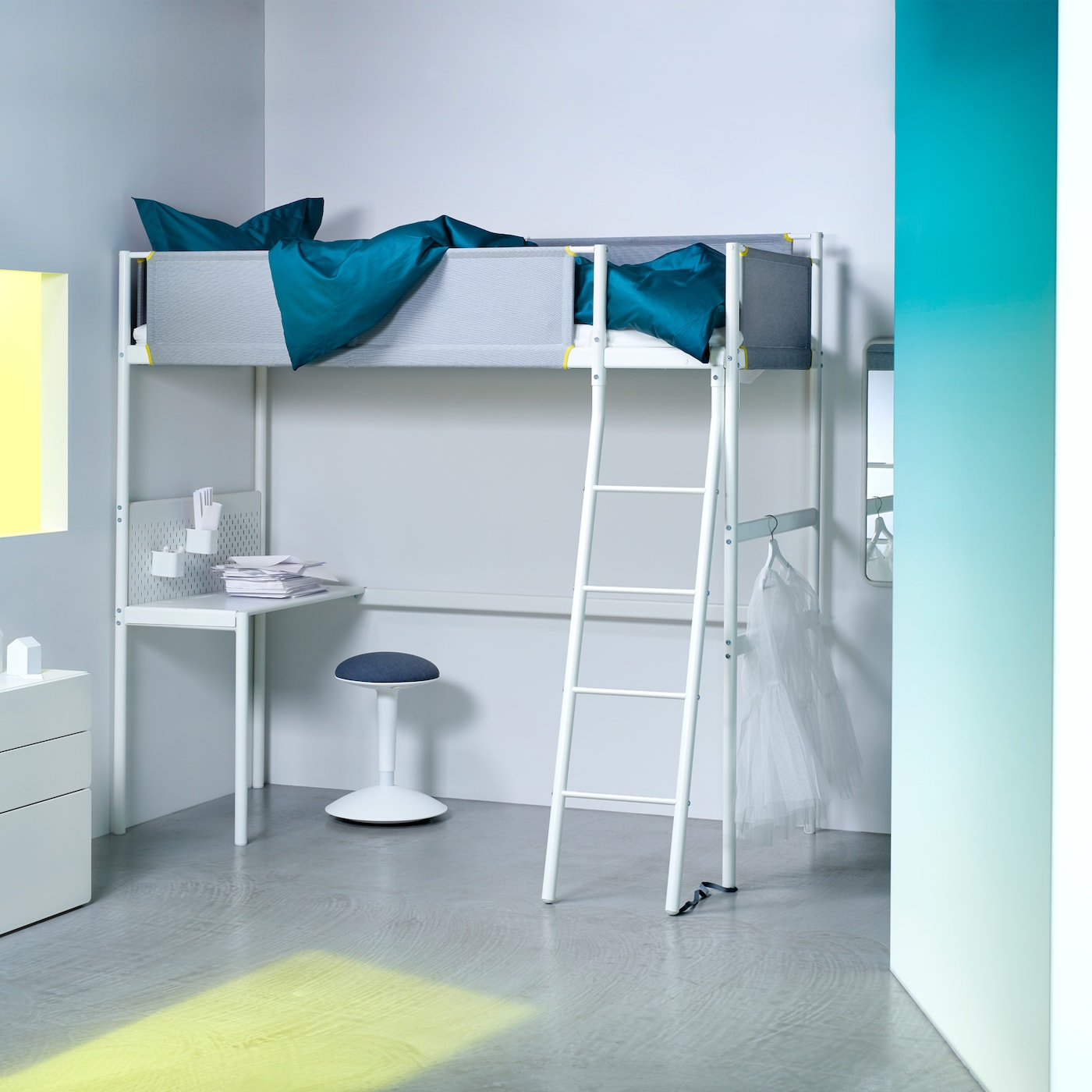The white VITVAL loft bed with fabric guard rails, a ladder and an optional desk underneath.