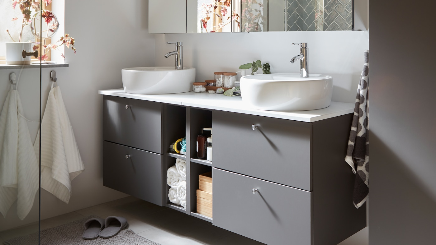 There are four drawers and four open compartments for storage in this grey GODMORGON/TOLKEN bathroom furniture.