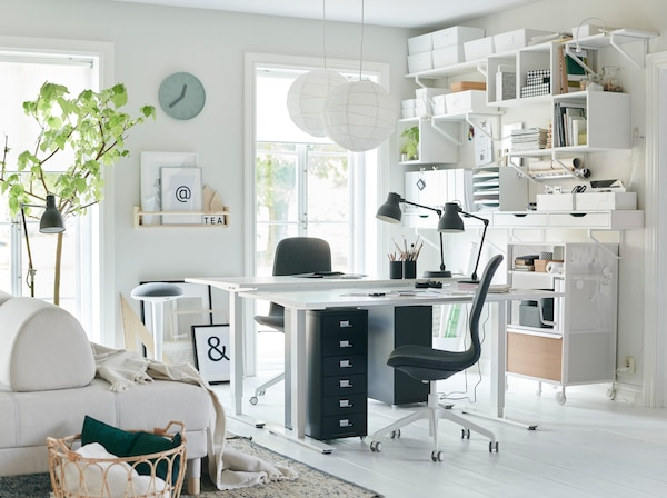 This all-white workspace stays organised with a wall for storage using IKEA EKBY storage cabinets and wall shelves. Let in some light and get to work!