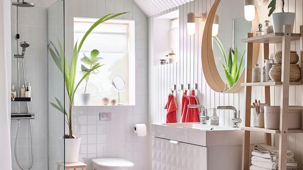 This IKEA white and red colour-schemed bathroom includes GODMORGON white double wash basin to allow multiple family members to be in the bathroom at the same time.