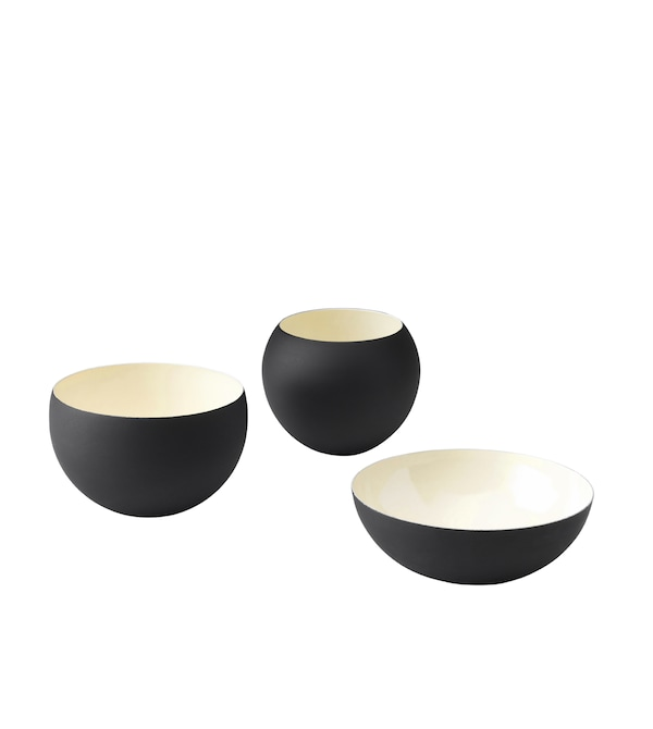 Three black and ivory bowls in different shapes and sizes.