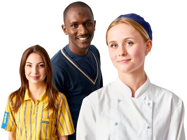 Three co-workers with three different uniforms against a white background.