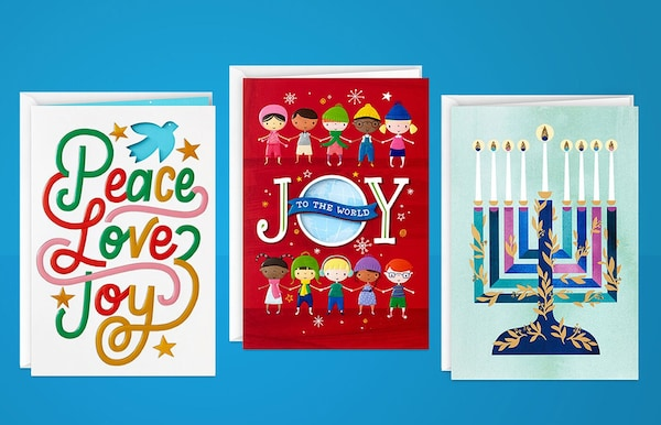 Three colourful cards, one reading 'Peace, Love, Joy', another reading 'Joy to the world', and a lit menorah on the third.