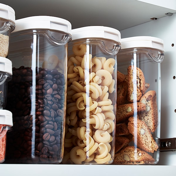 Three IKEA 365+ food containers side by side in a cupboard.