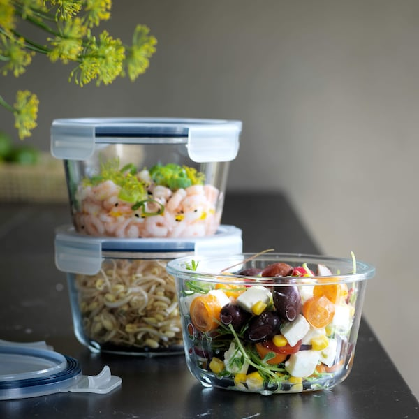 Three IKEA 365+ food containers with food in them