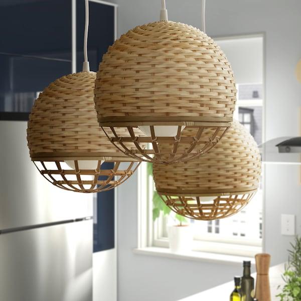 Three IKEA INDUSTRIELL round woven pendant lamps.