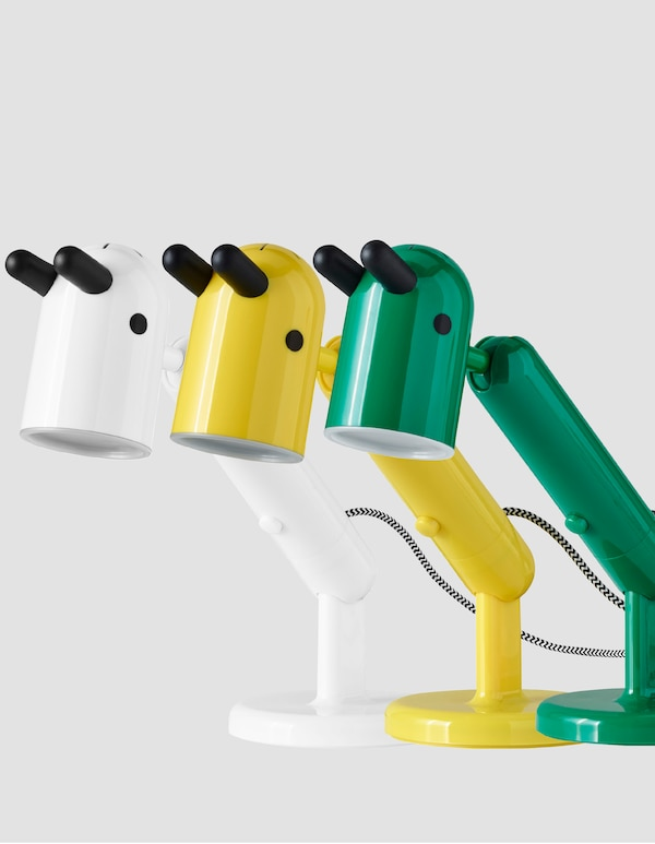 Three KRUX lamps in white, yellow and green.
