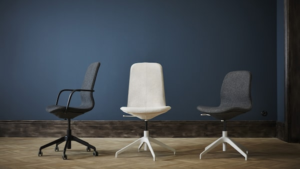 Three office chairs in various styles and colours