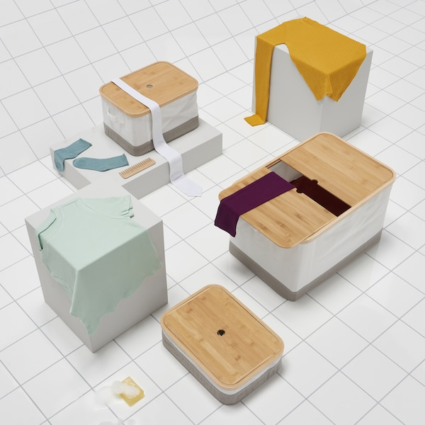Three RABBLA boxes in different sizes on a white tiled floor.