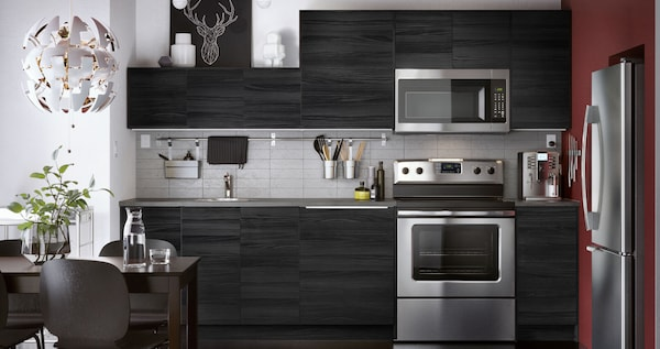 TINGSRYD kitchen in black with a wood effect, stripped door with a dark tone.