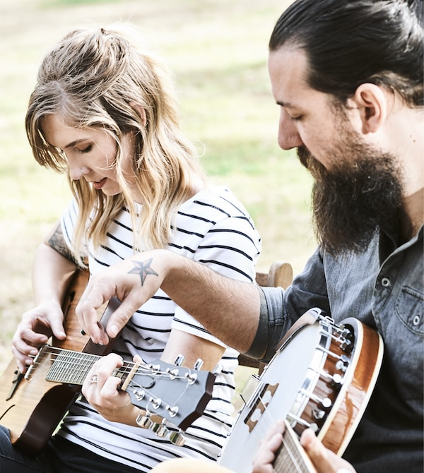 Toni and Karlton playing musical instruments.