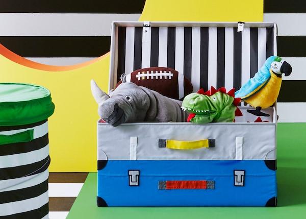 Toy animals sitting in FLYTTBAR children's storage series.