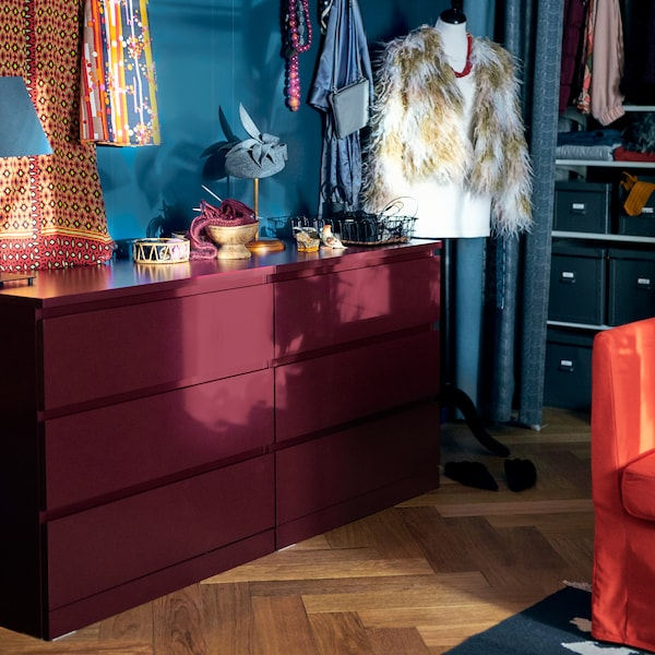 Try the stylish IKEA MALM dark red chest of three drawers for storing stuff you don't want to show off.