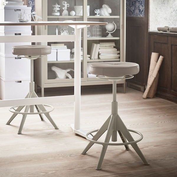 Two beige coloured TROLLBERGET chairs are placed facing each other.