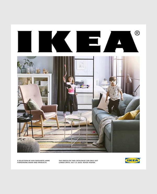 Two children in a living room on the cover of the new IKEA 2019 catalogue.