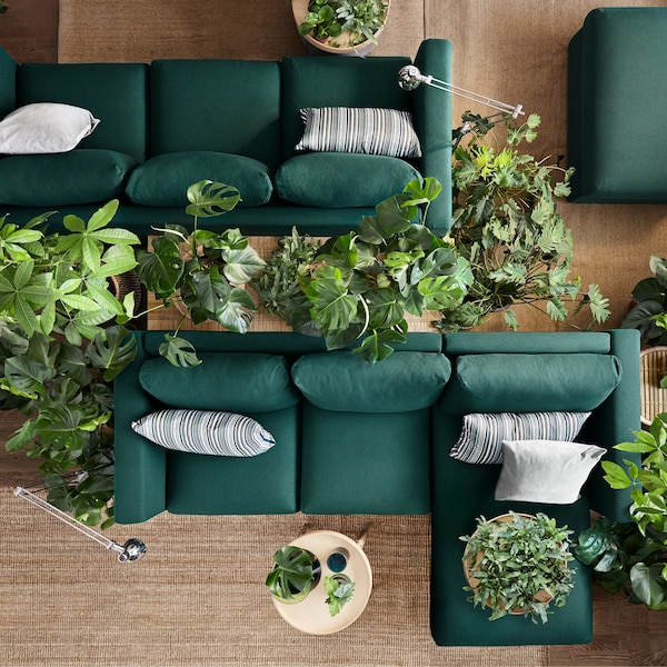 Two dark green IKEA VIMLE three-seater sofa sectionals, that are modular and come with removable sofa covers to change style.