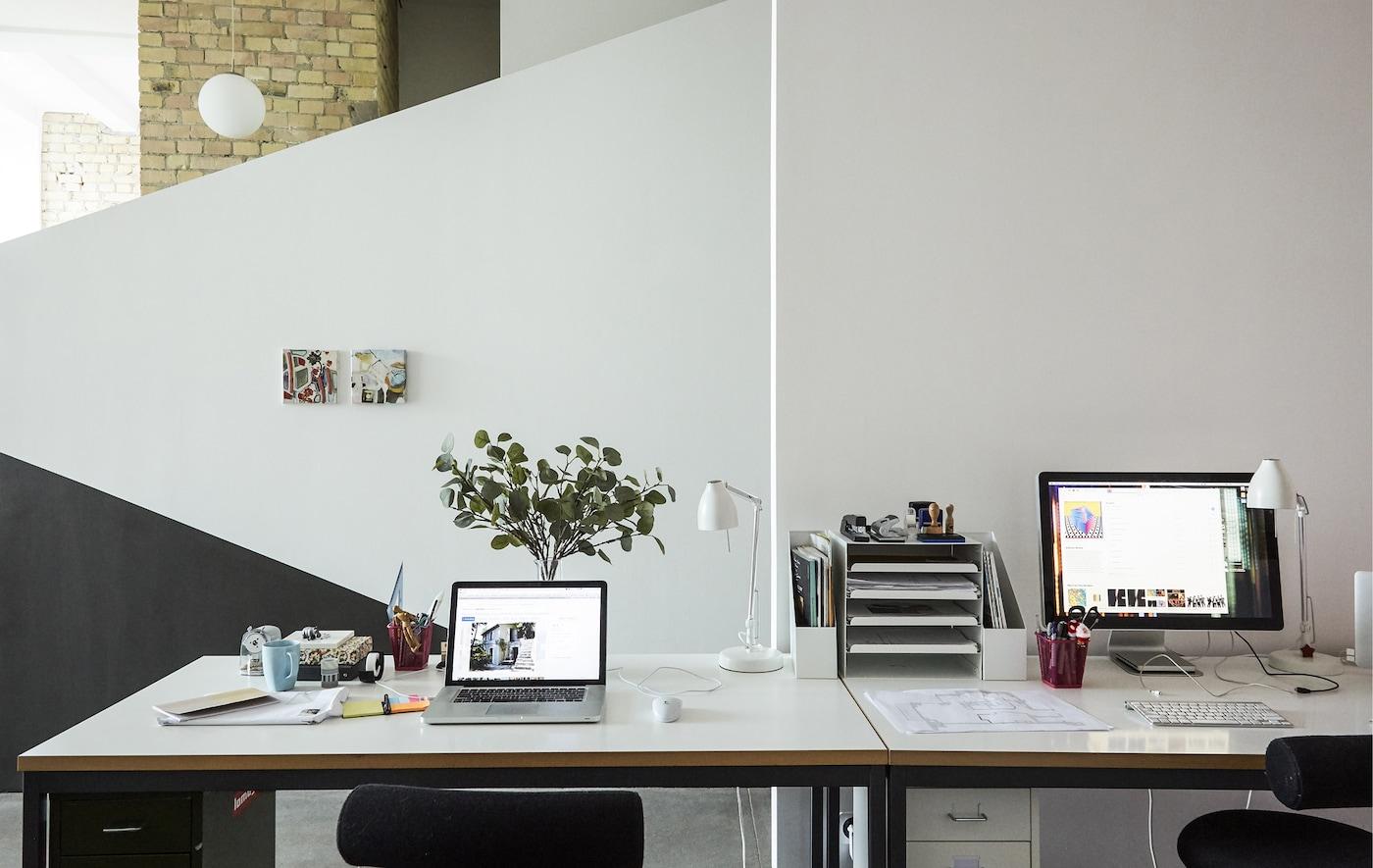 Two desks side by side.