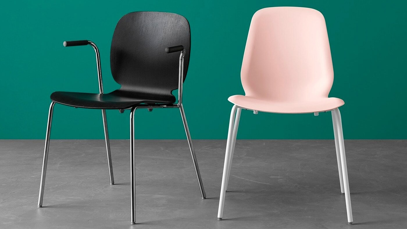 Two dining chairs of different colours and models.