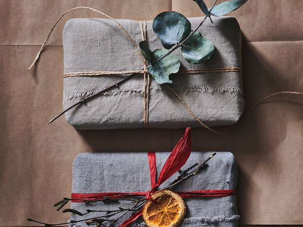Two gifts wrapped in fabric