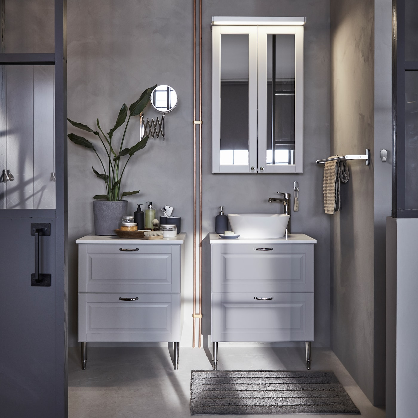 Two IKEA GODMORGON grey bathroom cabinets, each with two deep bathroom drawers and chrome-plated handles.