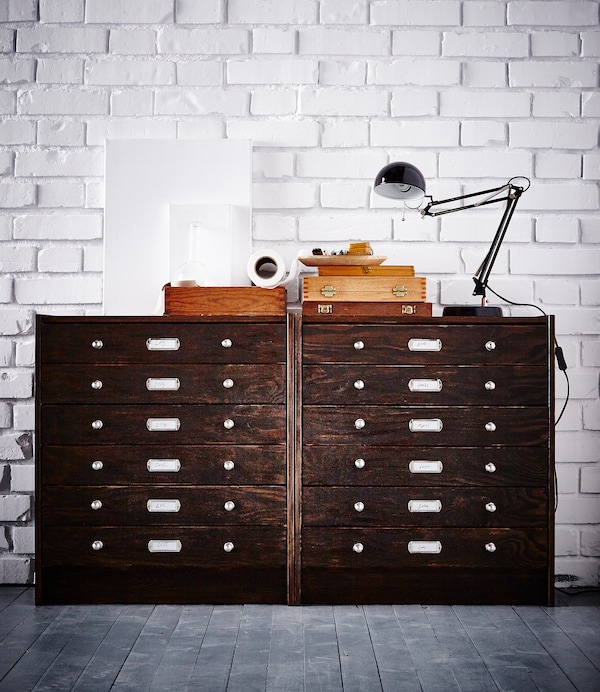 Two IKEA RAST chests stand against a white brick wall. They've been hacked to look like vintage filing cabinets.