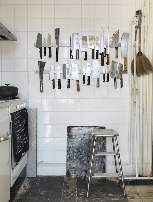 Two magnetic knife racks mounted on a wall.