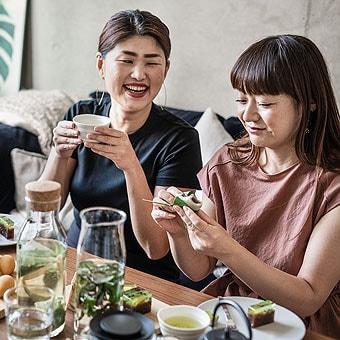 Two people enjoying lunch.