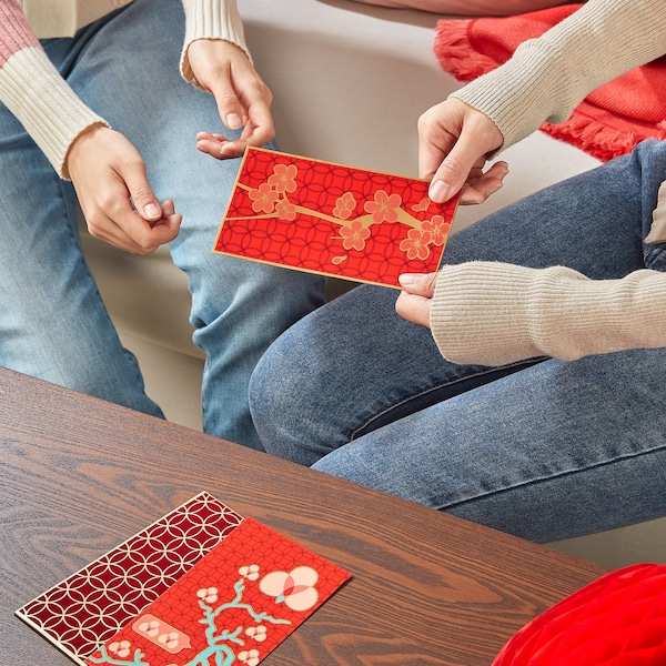 Two people exchanging money pockets for Lunar new year.