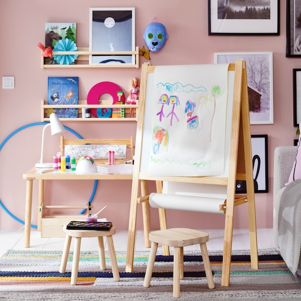 Two stools in front of a white board for kids.