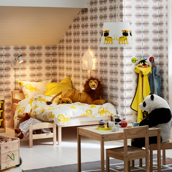 Two SUNDVIK beds with KÄPPHÄST blanket covers and pillowcases stand in a bedroom with a pillow and toys on the floor.