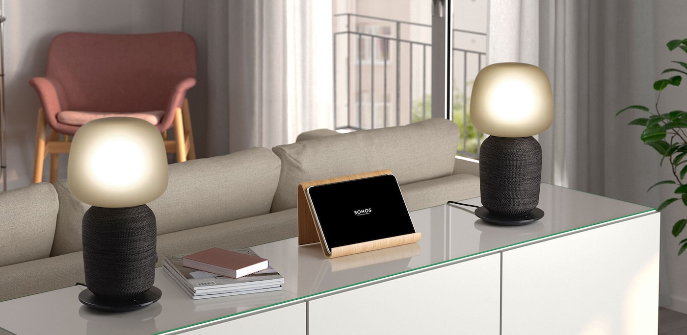 Two SYMFONISK table lamp with WiFi speaker units placed on a cabinet to create a stereo pair.