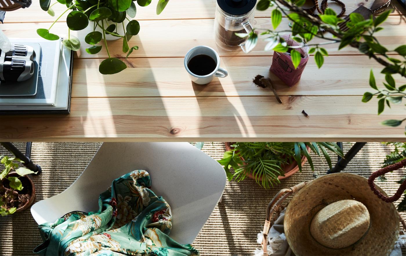Una mesa de desayuno con muchas plantas reales y artificiales, como la planta artificial en maceta FEJKA.