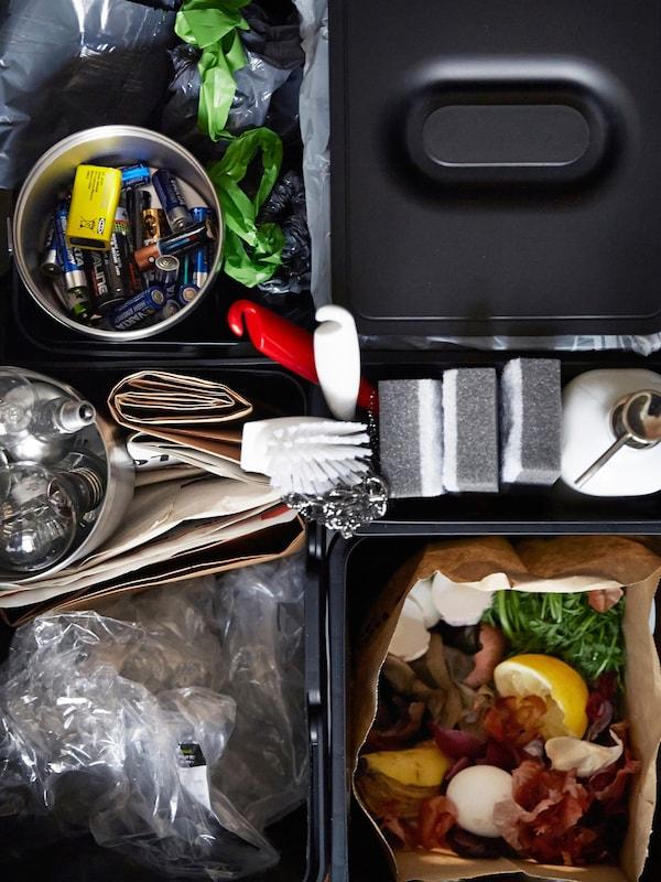 Una vista de pájaro de un cajón de clasificación de basura, diseñado para simplificar el reciclaje.