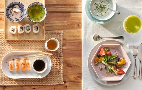 Une table à deux façons: une pour les sushis avec une assiette ovale blanche et une autre pour la salade avec une assiette hexagonale rose.