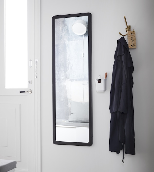 Update your small hallway with smart solutions by using hallway storage from IKEA. In a hurry and need a quick fix? Keep your favourite scent and some lipstick in a cutlery stand by the mirror, and you'll be made up and ready to go in a heartbeat.